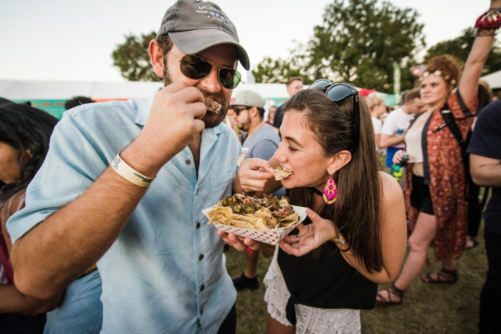 Man and woman sharing Sloppy Nachos from Salt Lick BBQ at ACL Eats at Austin City Limits Music Festival