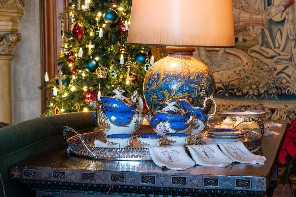 A tea set sits in the Tapestry Gallery during Christmas at Biltmore