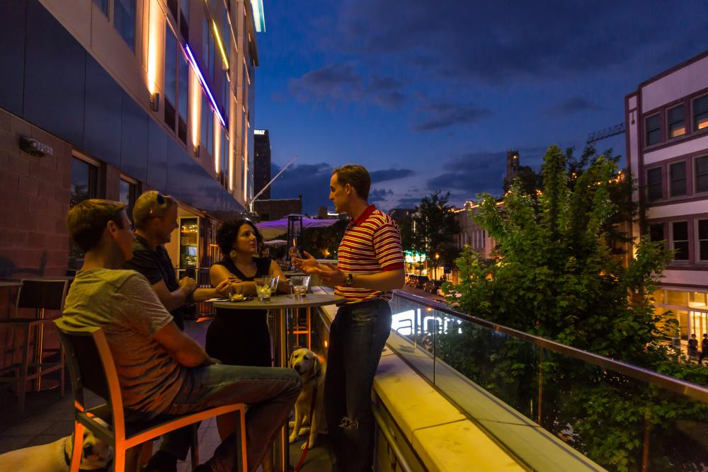 Enjoy views of downtown Asheville from the WXYZ Lounge rooftop bar