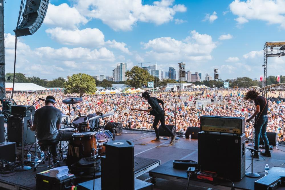 Band performing on stage looking out to crowd at ACL music Fest austin texas