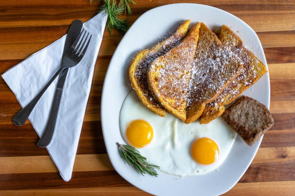 seasonal Pumpkin French Toast with sausage and two eggs from Kerbey Lane Cafe in austin texas