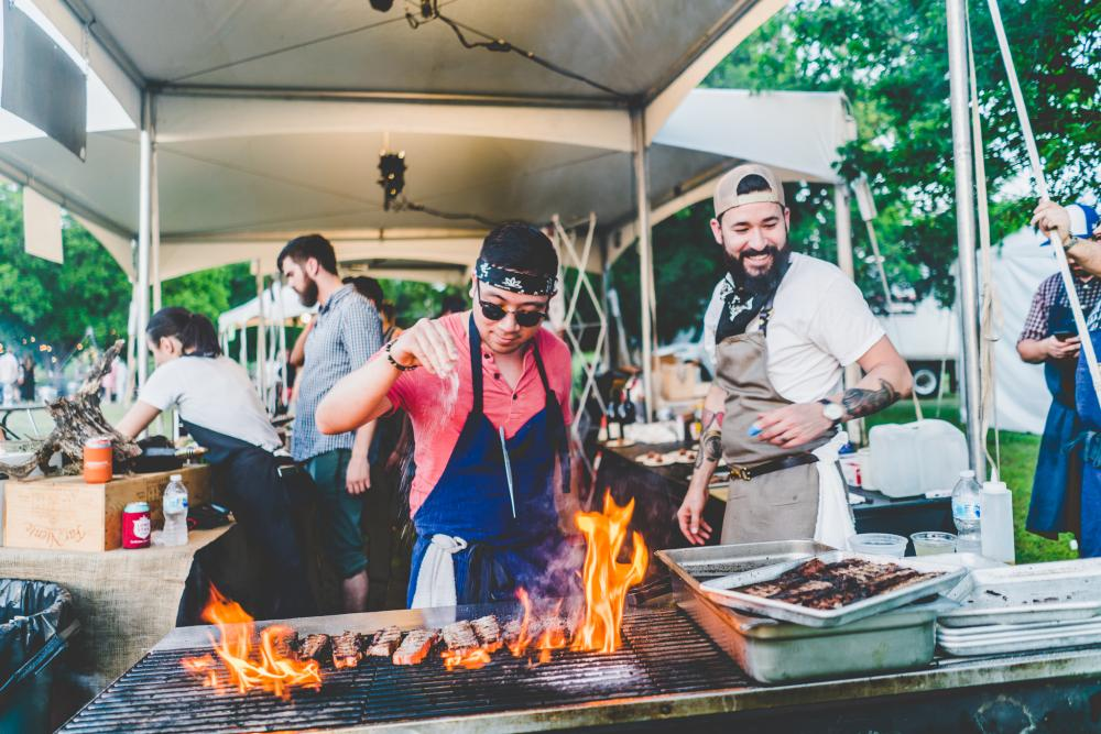 chef cooks on grill at Al Fuego event for Hot Luck Food and music festival in austin texas