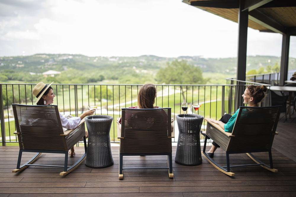 women relaxing on porch at Omni Barton Creek Resort Spa in austin texas