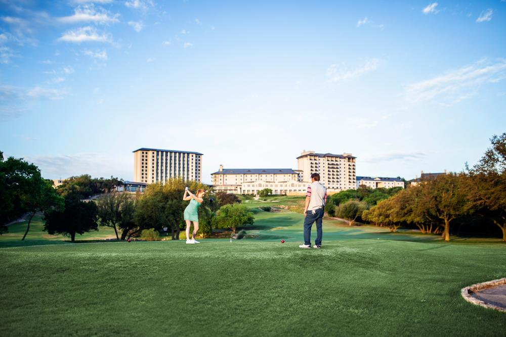Couple playing on the Golf Course at Omni Barton Creek Resort and Spa in austin texas