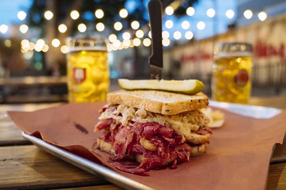 sandwich and beer at Scholz Garten german restaurant and beer garden in austin texas