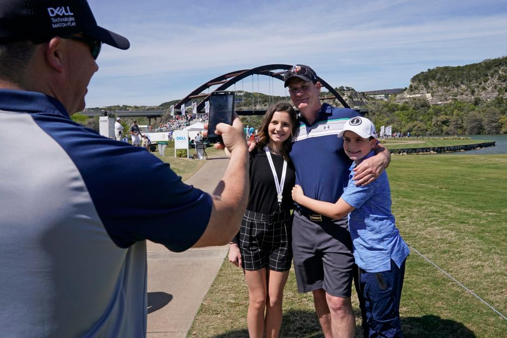 fans gather for a photo at World Golf Championships Dell Match Play in austin texas