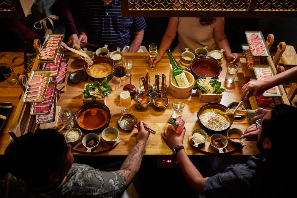 People dining around table at Dipdipdip Tatsu ya hot pot restaurant in austin texas