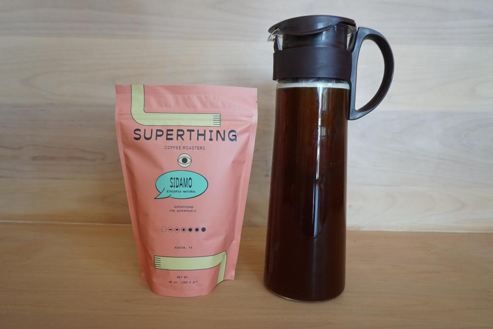 Bag of Superthing Coffee next to cold brew coffee from Patika in Austin Texas