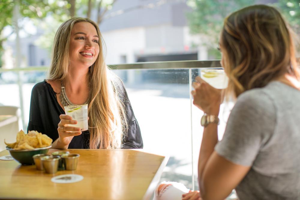 women drinking margaritas at la condesa in 2ND Street District in austin texas