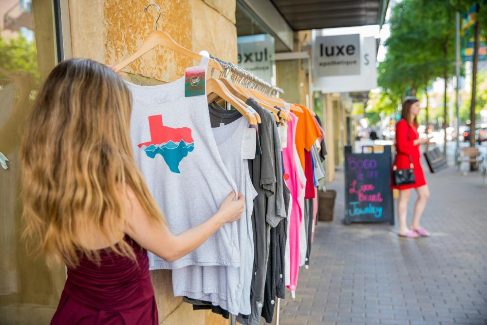 woman shopping at luxe apothetique in 2ND Street District in austin texas