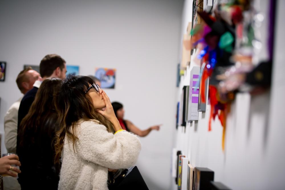 Woman looking at artwork during East Austin Studio Tour in austin texas