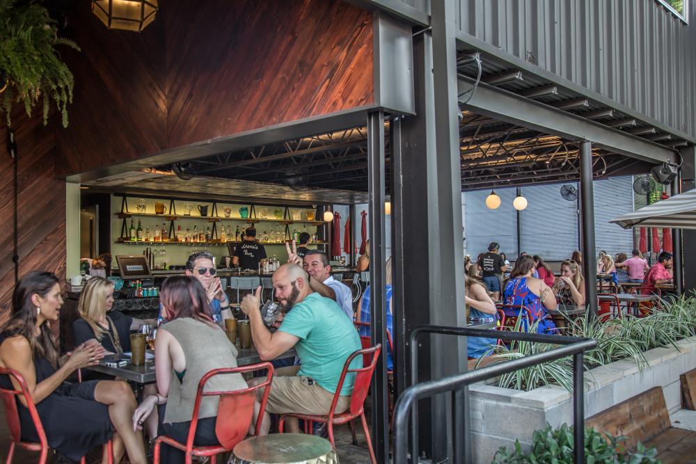 People dining on Irenes Patio in Austin Texas