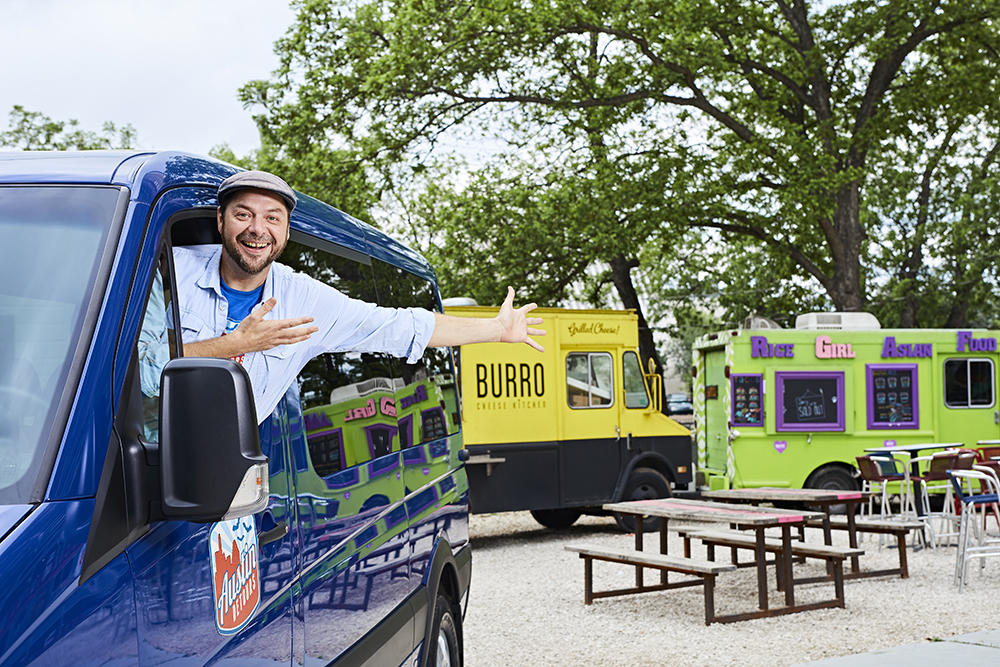Austin Detours tour guide shows off food trucks from van in austin texas