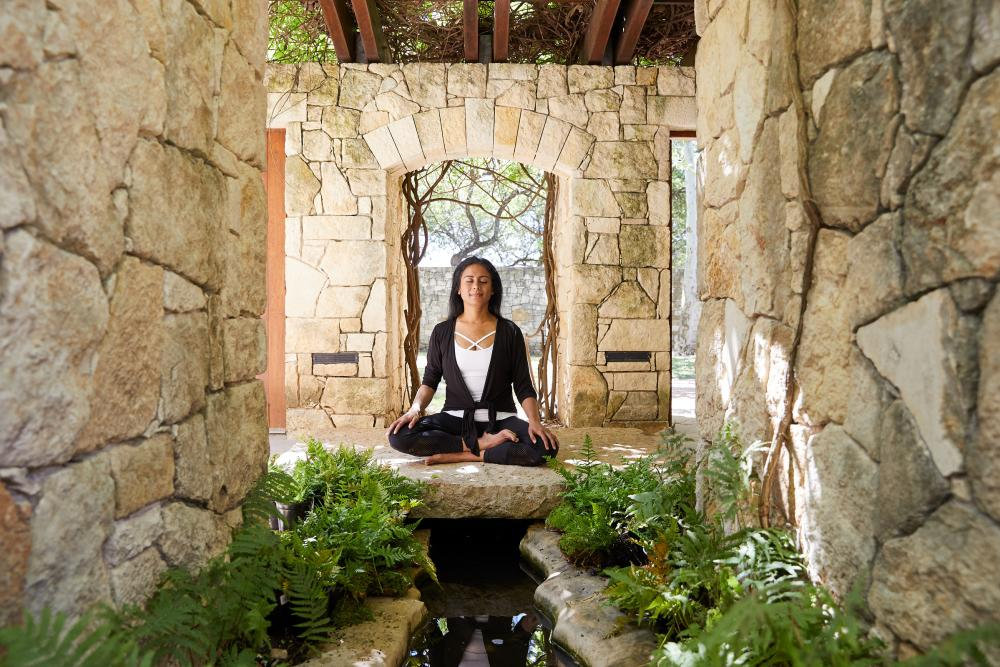 woman in seated Meditation at Miraval resort and spa in Austin texas