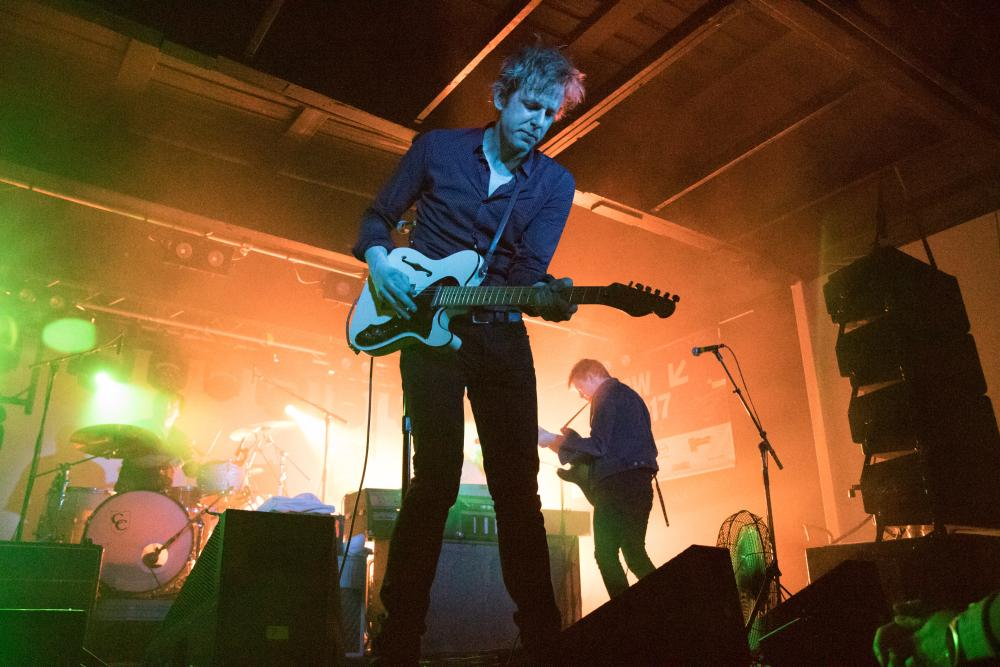Spoon performing on stage at SXSW
