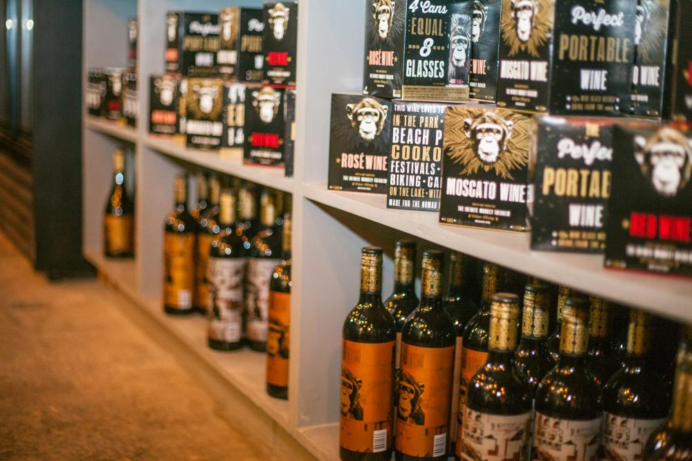 Wine bottles and cans on shelf at Infinite Monkey Theorem in austin texas