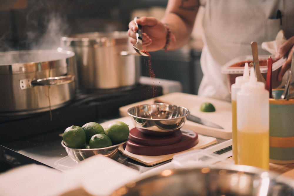 Chef Fermin Nunez prepares a dish in the kitchen of Suerte in Austin Texas