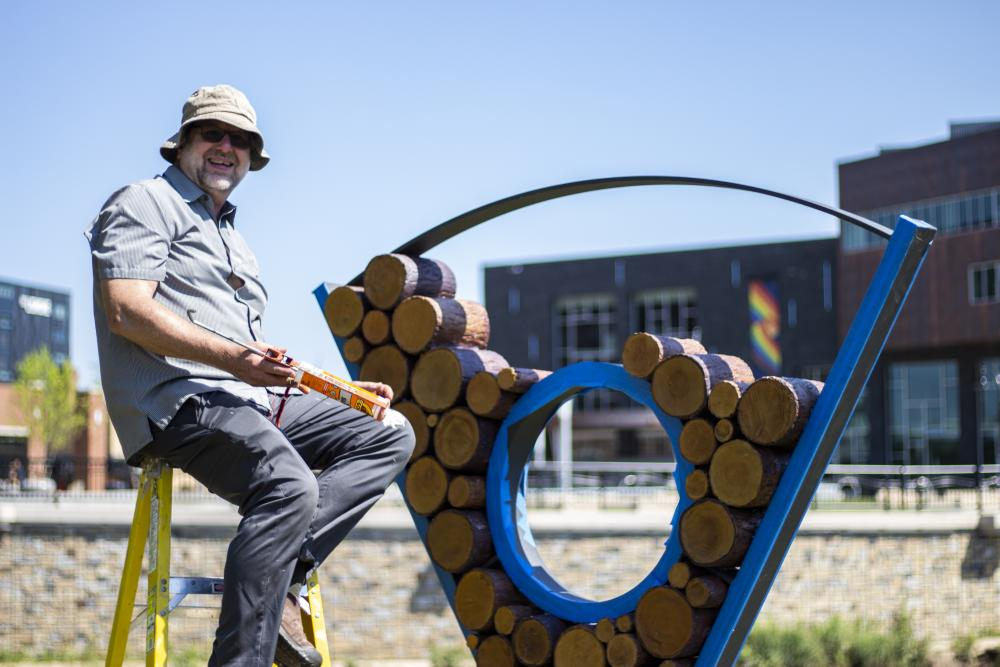 Artist Dan Ingersoll works on his sculpture 'Ingrain,' located in central Eau Clair.