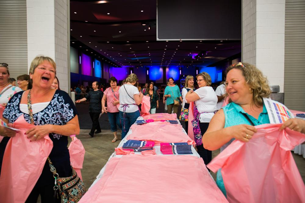 Shoppers entering the Vera Bradley Annual Outlet Sale