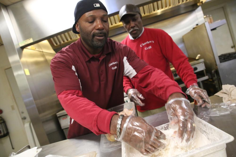 Charles Washington prepares an order in the kitchen of Charlow's Grill