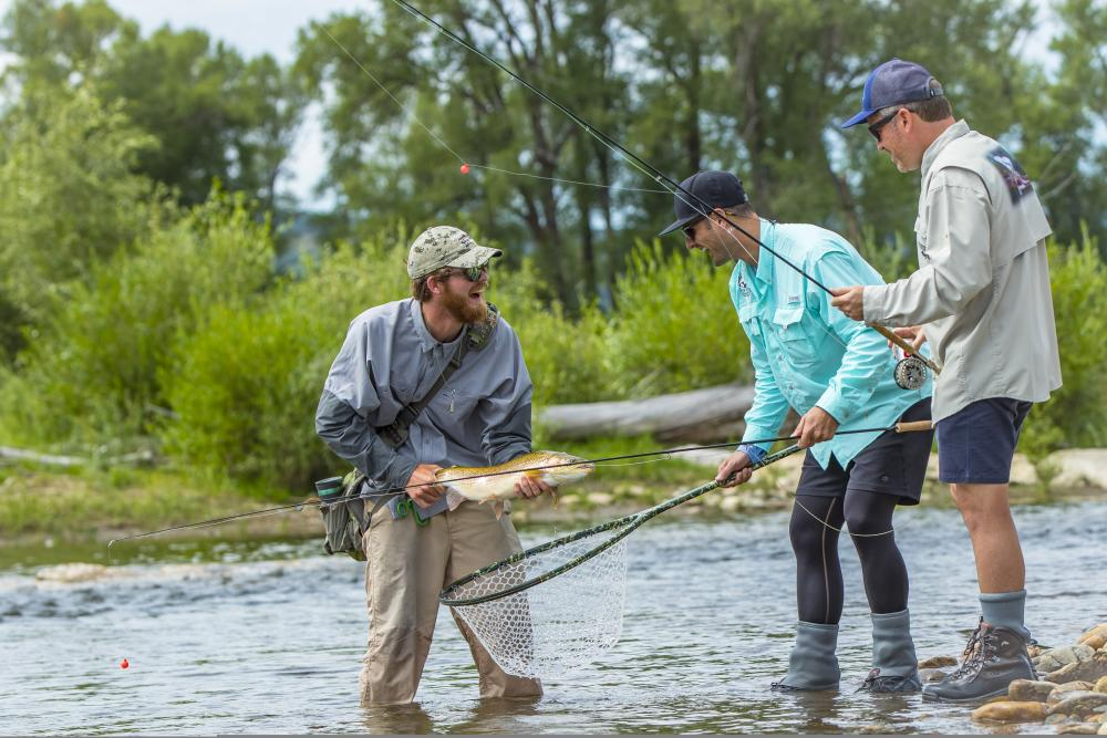 anglers rejoice after their big catch on the yampa river