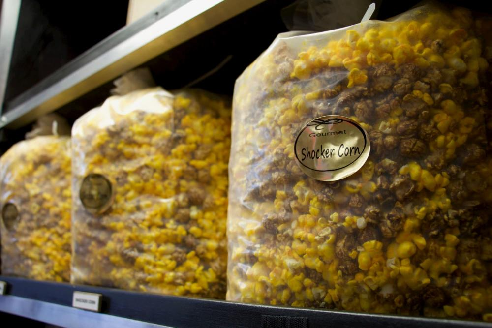 Bags of popcorn sit on shelves at Kernel's Popcorn Express in Wichita