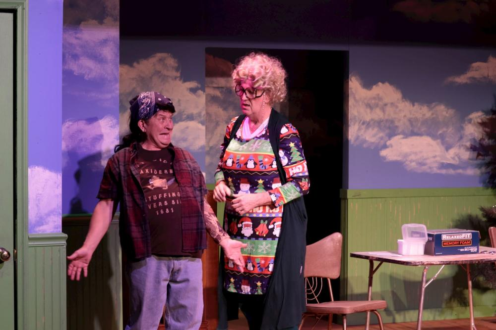 Two performers on stage at Roxy's act out A Tuna Christmas