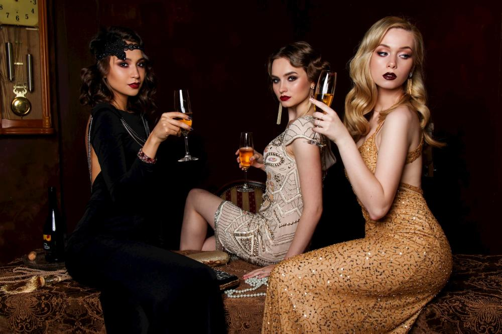 Three women enjoy champagne for New Years Eve