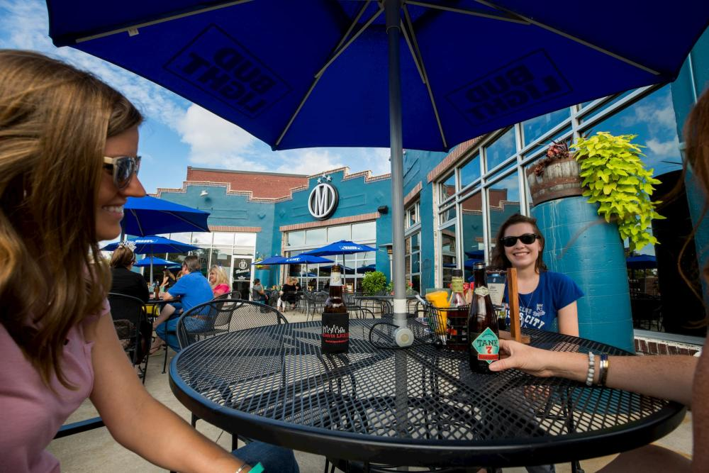 Wichita visitors enjoying drinks on a restaurant patio