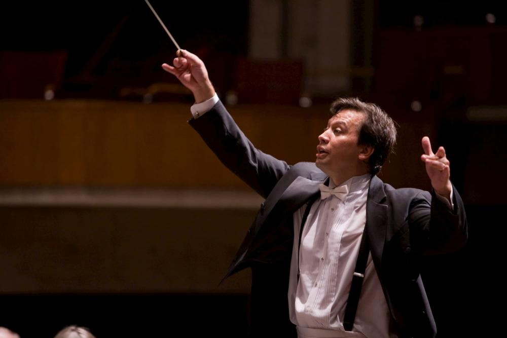 A conductor works with the Wichita Symphony Orchestra