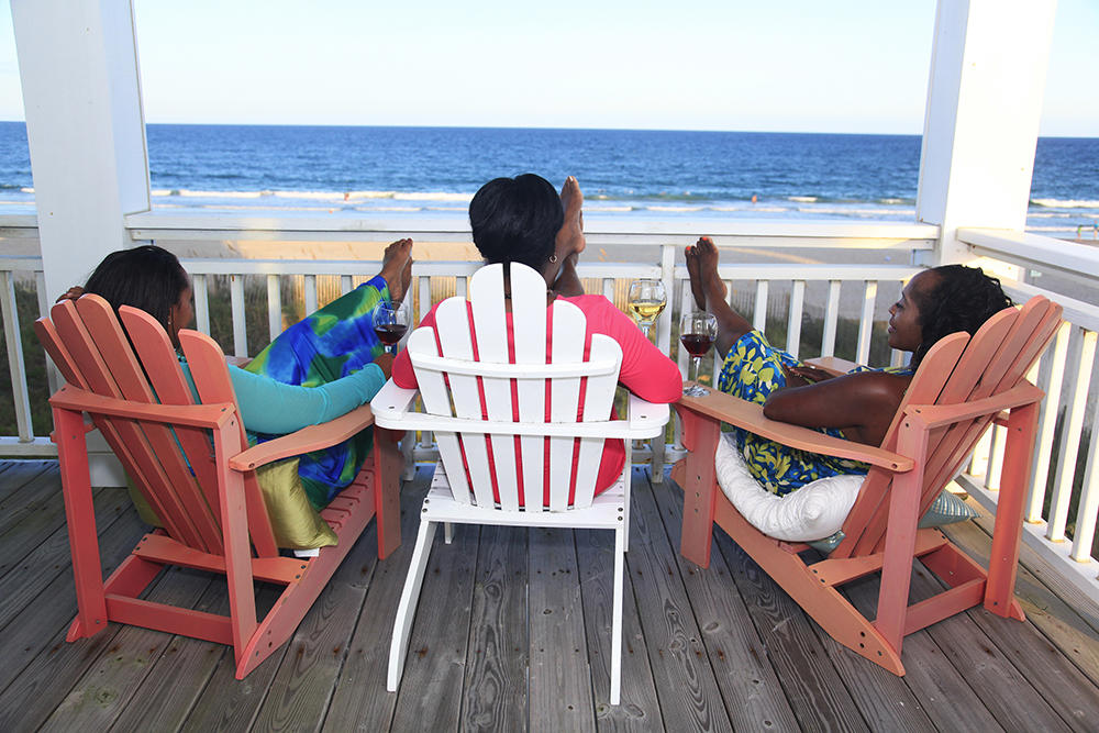 Three women relaxing on a deck in Wrightsville Beach