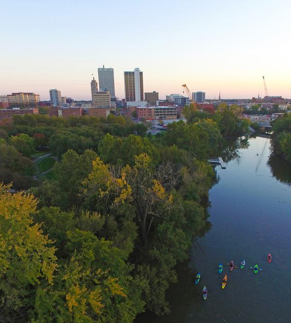 Kayakers Cruise the Downtown Rivers at Sunset