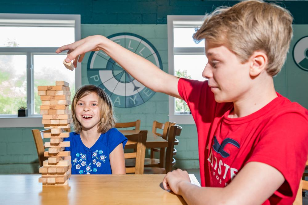 Children play at game at Well Played Board Game Cafe