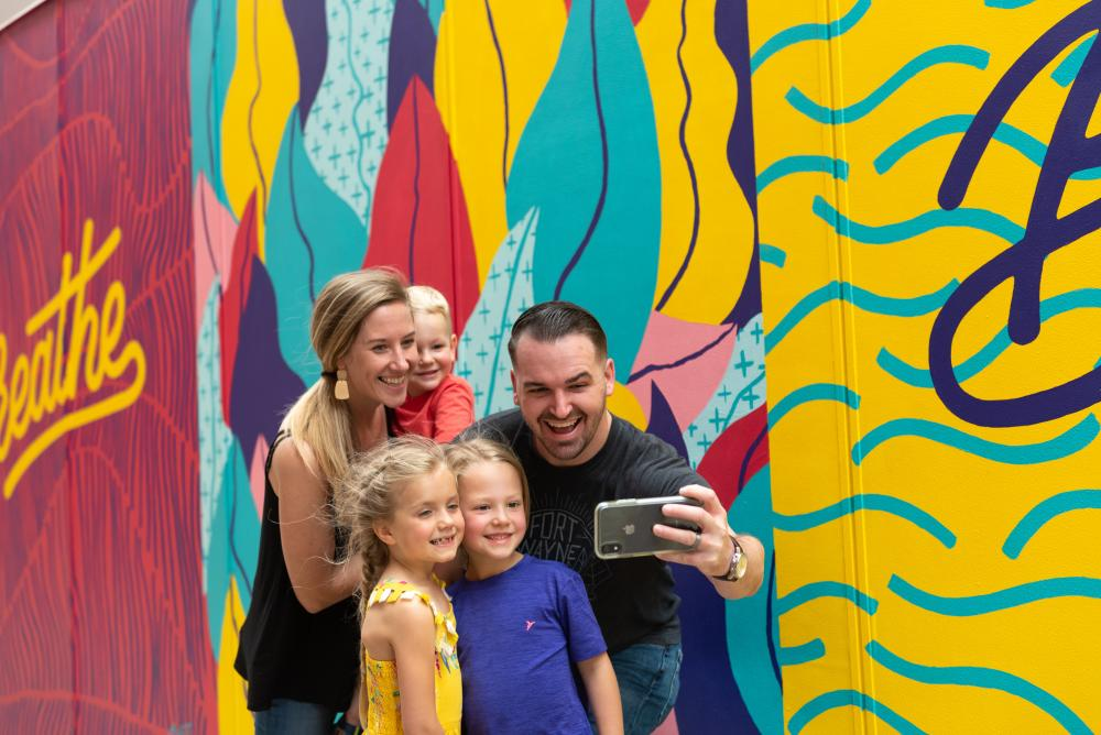 Family exploring the murals in Downtown Fort Wayne