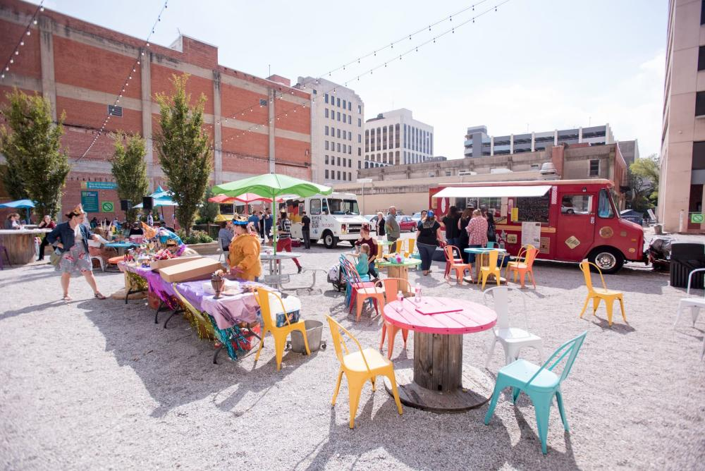Patrons eat lunch at ICT Pop-Up Urban Park at food trucks in Wichita KS