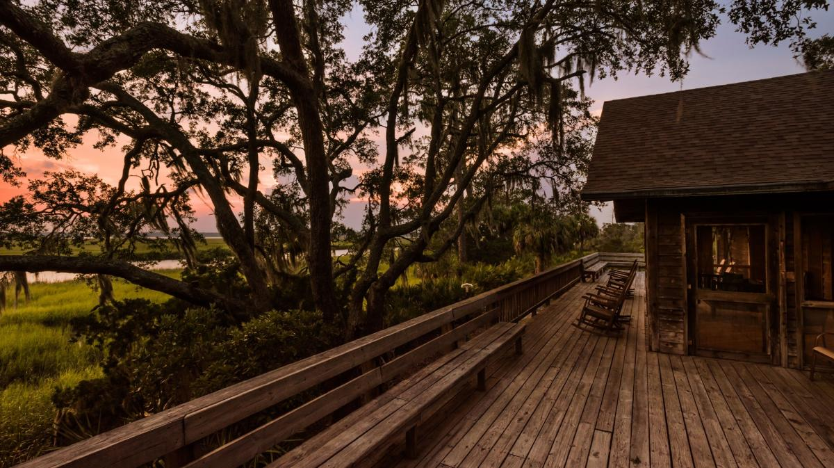 Little St. Simons Island's River Lodge has an expansive back porch perfect for watching wildlife and beautiful sunsets.