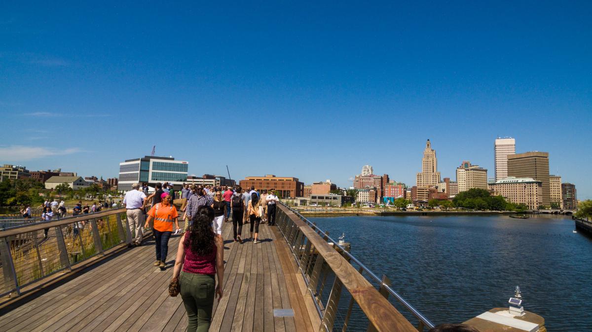 Visitors walk along the Pedestrian Bridge in Providence, RI