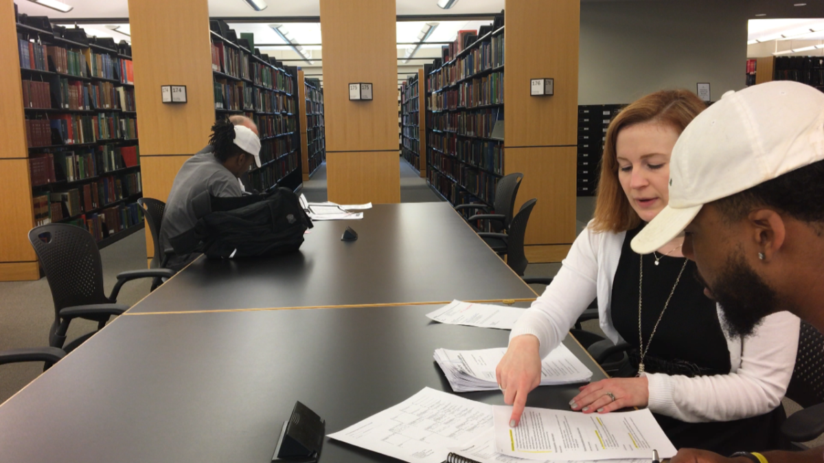 Sampson Levingston researching his family history with Genealogist, Allison Singleton, at the Genealogy Center in Fort Wayne, Indiana