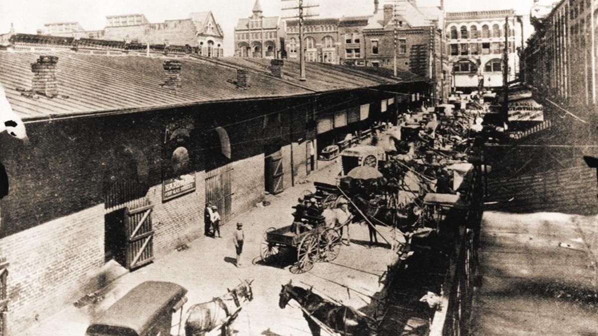 Market Square traders on the east side of the Market House looking north towards City Hall courtesy of McClung Historical Collection.