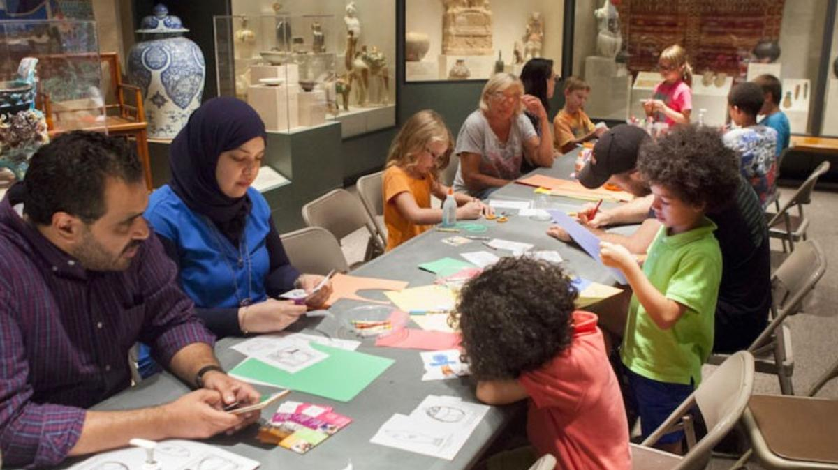 Families doing crafts during family day mcClung Museum