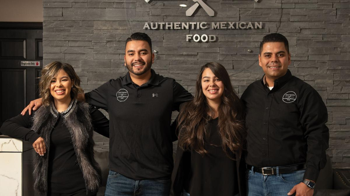 Melody, Hugo, Michelle, and Sergio Rios serve authentic aguas frescas.