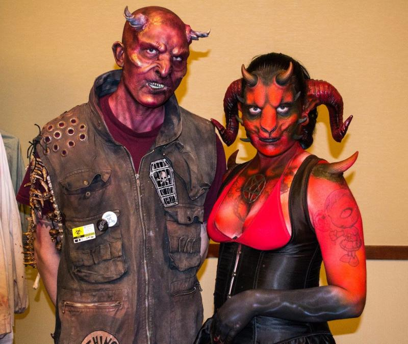 Cosplayers dressed as red demons