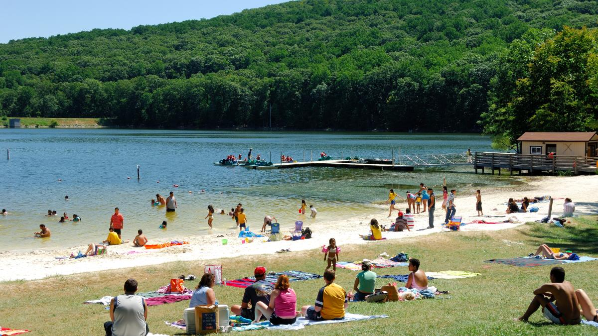 Cool off after your hike by relaxing on the beach at William Houck Lake, just steps from the trails to Cunningham Falls.
