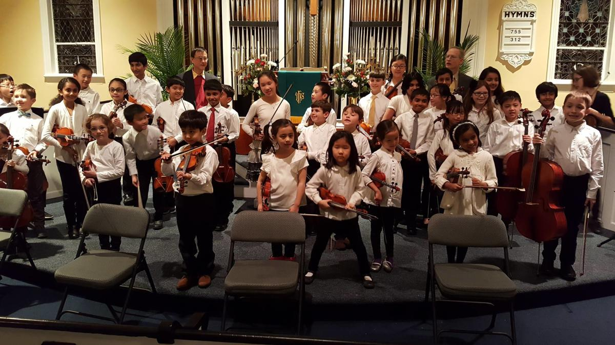 Princeton String Academy child musicians holding instruments