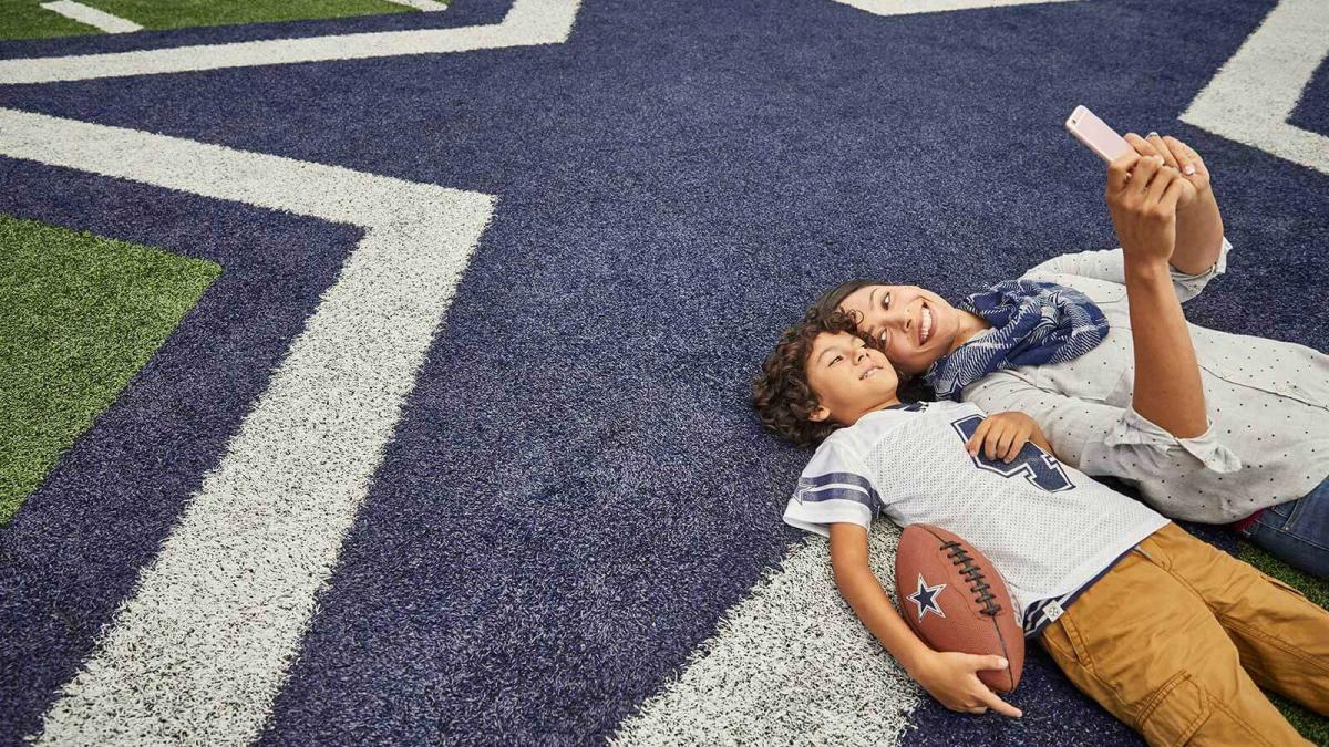 Mom and Son on AT&T Stadium Field