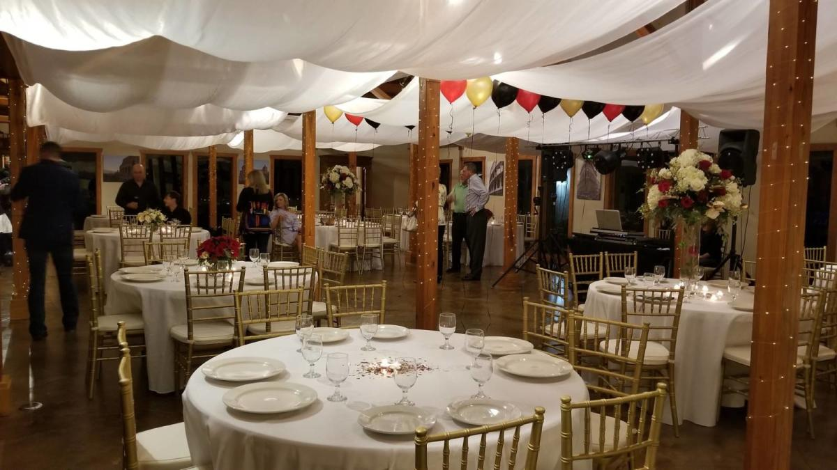 Tented Meeting Area With Round Tables