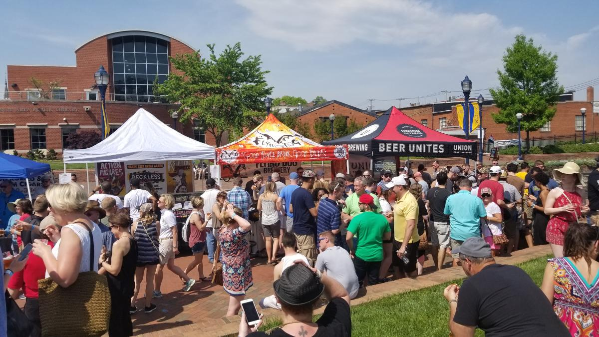 People Visiting Vendors at the Craft Beer Festival