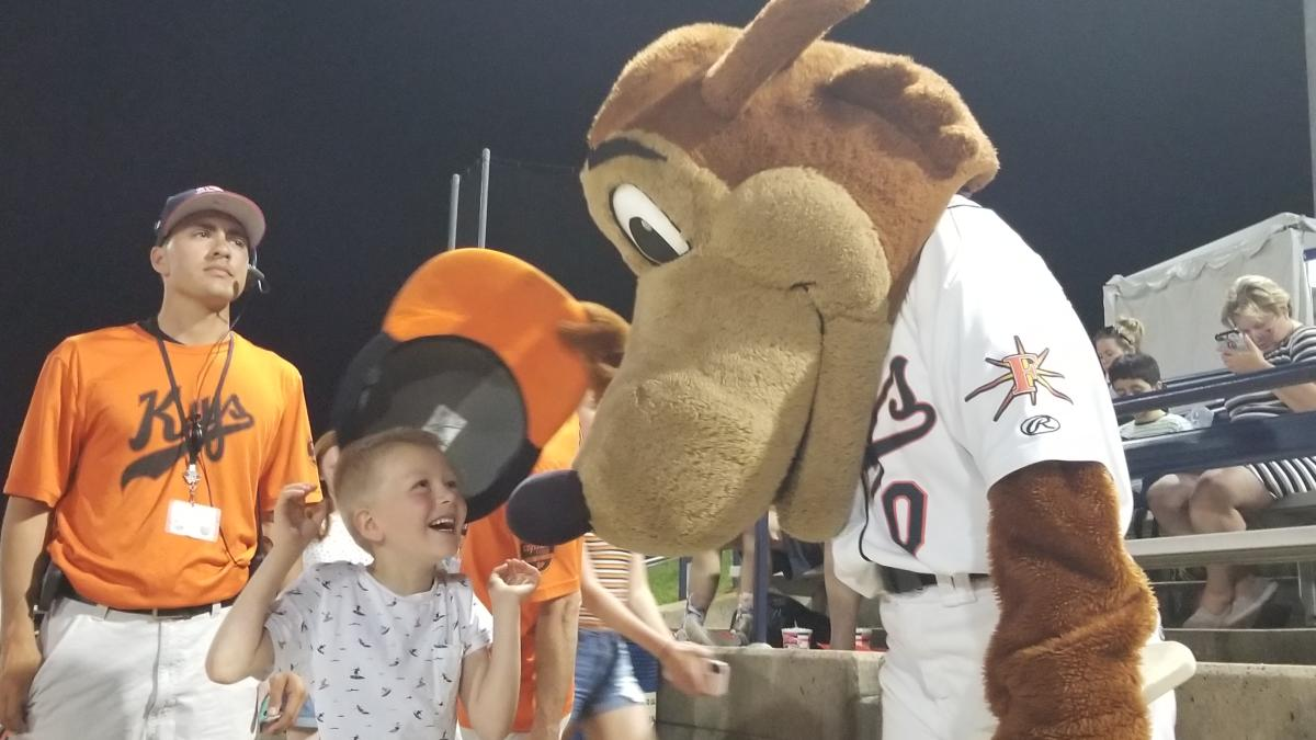 Kid at Talking to the Keyote Mascot at a Keys Game