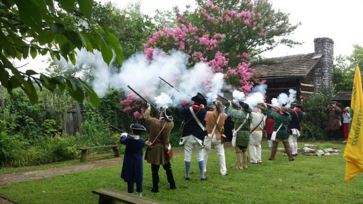 Men in Colonial Outfits Firing Guns in the Air at the James White Fort