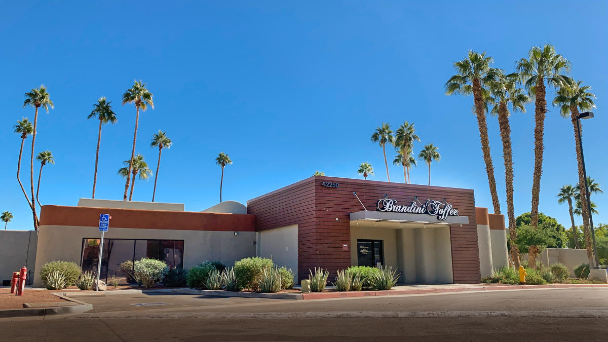 Blue sky and palm trees surround Brandini Toffee in Rancho Mirage